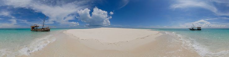 Sandbar near Mange reef. In between the mainland of Tanzania and Mafia Island, the sea is fairly shallow. At low tide, many sand bars appear from the sea. They are stunningly beautiful and surrounded by the pristine waters of the Indian Ocean.