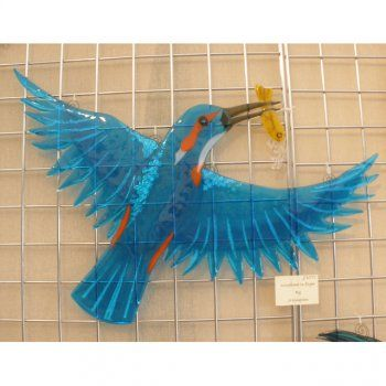 This beautiful kingfisher is made of fused glass.