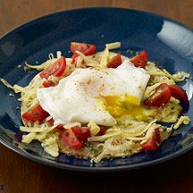 Migas    ~~~~ This version of the Tex-Mex favorite is a fork-and-knife affair, the egg yolk running into the green salsa for an unbeatable combination.