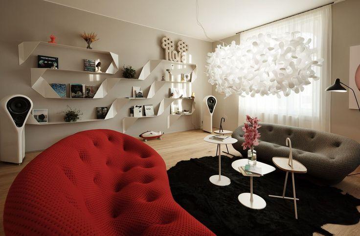 Dvě pohovky Ploum z Ligne Roset jsou ideální při použití ve volném prostoru. Dominantní svítidlo navrhla Anna Kozová.