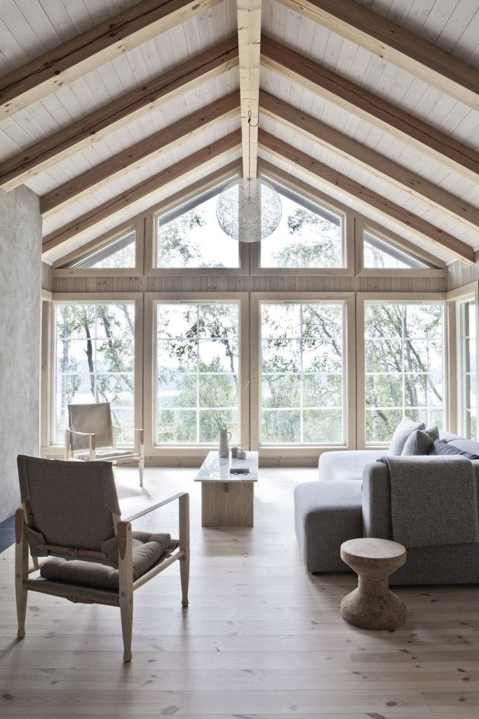 Wood and marble Solid table in a beautiful wooden house with a Scandinavian interior