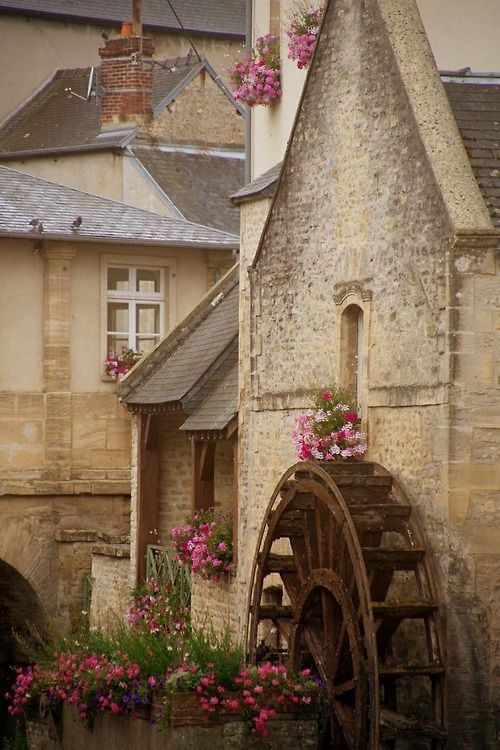 Bayeux, France. Have been there and seen this amazing water wheel in such a lovely pastoral setting.