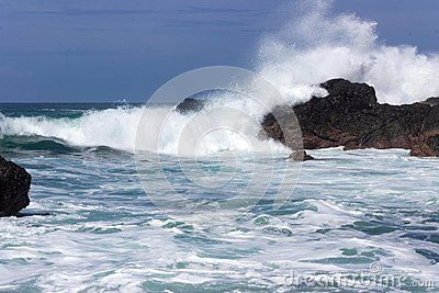 Massive implacable waves of the Pacific Ocean crash upon the unbreaking volcanic rock of Costa Rica`s Playa San Janillo.  Costa Rica`s Guanacaste Peninsula features some of the world`s most beautiful beaches.