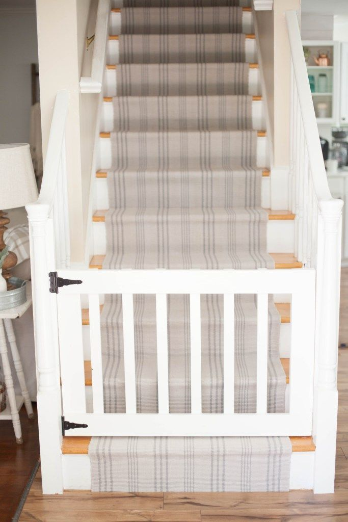 A simple guide to making a DIY stair runner using area rugs and carpet tape for a low cost solution for loud stairs! | DIY Stair Runner | Tips for Installing Your Own Stair Runner | How to Install a Stair Runner | DIY Home Improvement || Lauren McBride