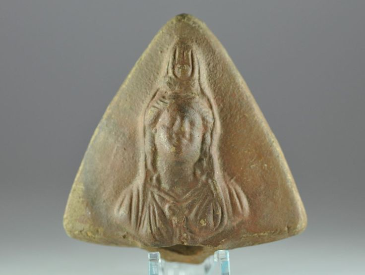 Roman oil lamp handle with Isis, 2nd-3rd century A.D. Roman Egyptian terracotta two wicks oil lamp handle with Isis, 8.7 cm long. Private collection