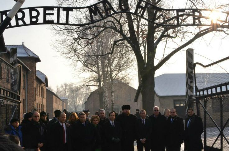 Official delegations of Polish Sejm and Israeli Knesset under the 'Arbeit macht frei' gate at the former Auschwitz I camp.