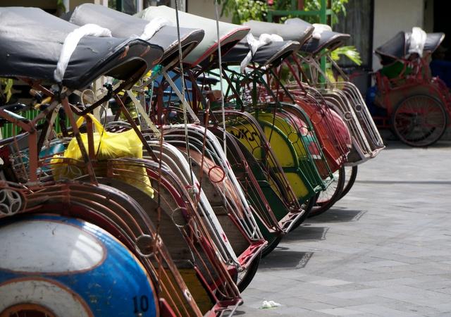 Jogja, Indonesia. Becaks are still popular modes of transportation in Yogyakarta.