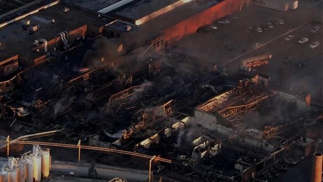 Newly Weds Foods To Assess Factory Damage After Massive Fire Fire Damage Restoration Chicago Elmwood Park Northbroo Wedding Food Fire Chicago Fire Department