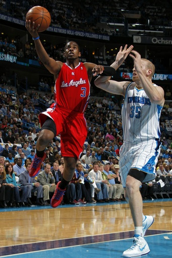 Chris Paul goes to the basket against Chris Kaman. It's the first time CP3 played against the New Orleans Hornets since his trade to the Clippers. The Clippers lost 97-90. #NBA #basketball