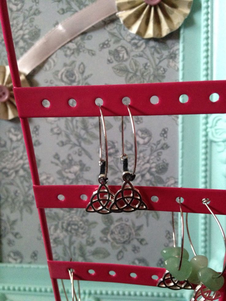 A personal favourite from my Etsy shop https://www.etsy.com/uk/listing/451001042/triquetra-hoop-earring-with-black-links
