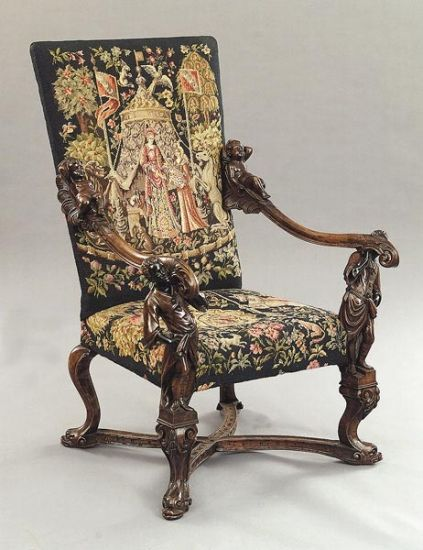 A Venetian Carved Walnut Armchair, late 19th c., in the manner of Andrea Brustolon, the rectangular canted needlepoint (12/08/2001)