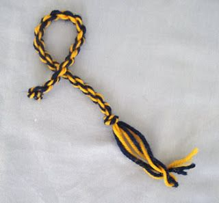 How to make a twisted cord.  Use yarn to make tie-back rope for curtains to re-attach the tassel.