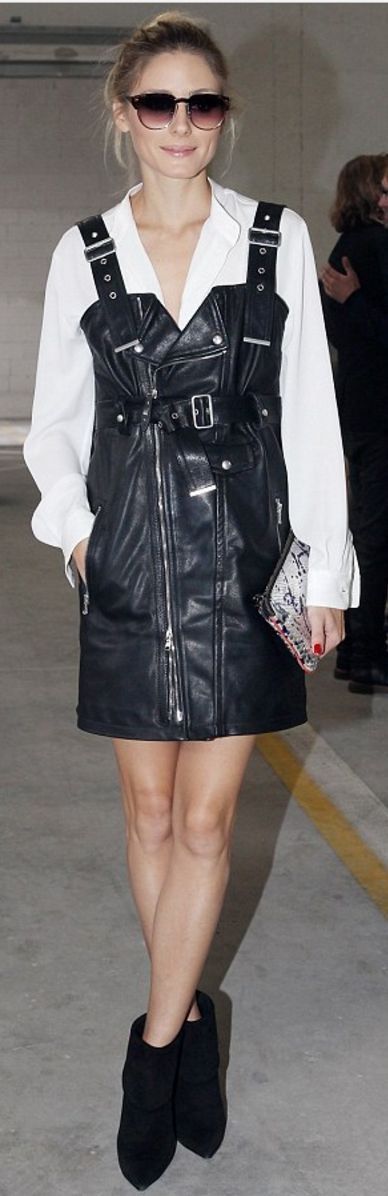 Who made  Olivia Palermo's black leather dress, sunglasses, and blue print handbag?