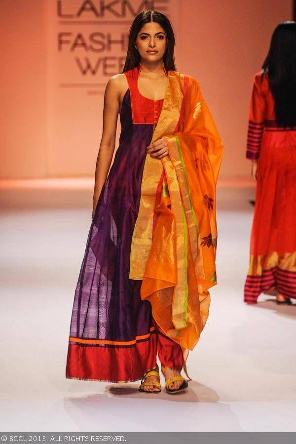Femina Miss India World 2008 Parvathy Omanakuttan showcases a creation by designer Rahul Mishra on Day 5 of the Lakme Fashion Week (LFW) Winter/Festive 2013, held at Grand Hyatt, Mumbai, on August 26, 2013.