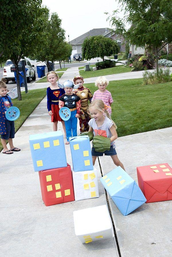 Superhero party, knocking down buildings