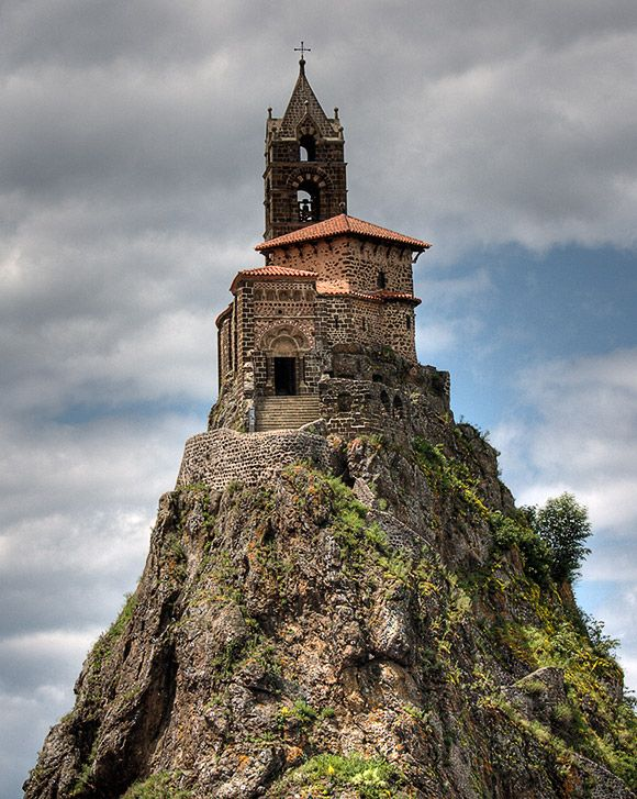 Saint-Michel d'Aiguilhe chapel (Le Puy-en-Velay, France) -Perhaps one of the most remarkable sights in France, a chapel perched on a volcanic plug. This is the Rock of Aiguilhe, on the edge of the town of Puy en Velay, in the Auvergne. The Chapelle Saint-Michel has stood there for 1042 years, since Bishop Gothescalk had it built in 962 on his return from a pilgrimage to Santiago del Compostella in Galicia. In 1955 workers found relics under the alter that had been there since it was built.