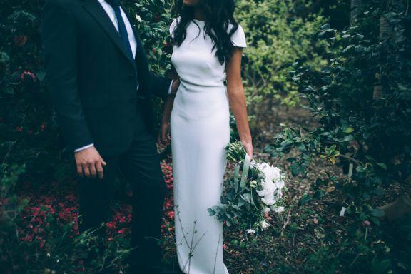 Utterly chic Carla Zampatti column wedding dress.  St Thomas Aquinas Wedding – I Got You Babe Photography.