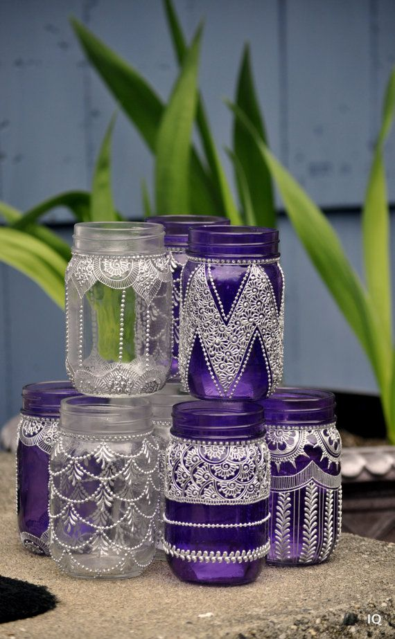 MASON JAR LANTERNS adorned with henna designs. Use them to decorate your house or for parties, wedding decor.. Each one has a different design drawn on it. The paint is very strong and durable because it is baked on. You could put candles in there or electric lights. Your choice. If