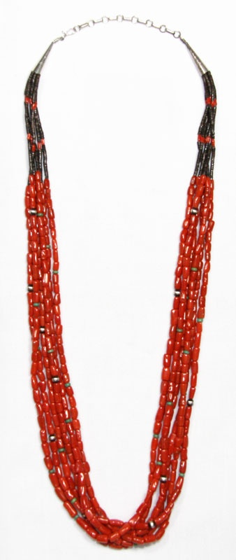 Nezhoni red ciral necklace with Campetos turquoise beads  and silver beads, olive shell heishei at neck line.