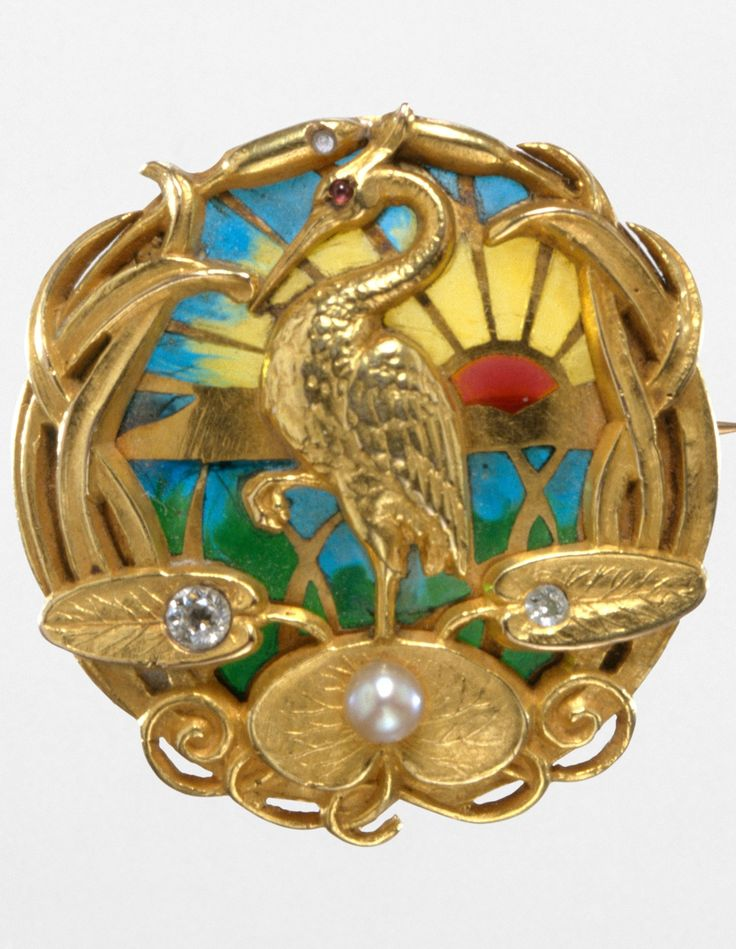 Riker Brothers - An Art Nouveau gold, plique-à-jour enamel, diamonds, pearl, and ruby watch pin, circa 1900. Diameter: 2.5cm. #Riker #ArtNouveau #WatchPin