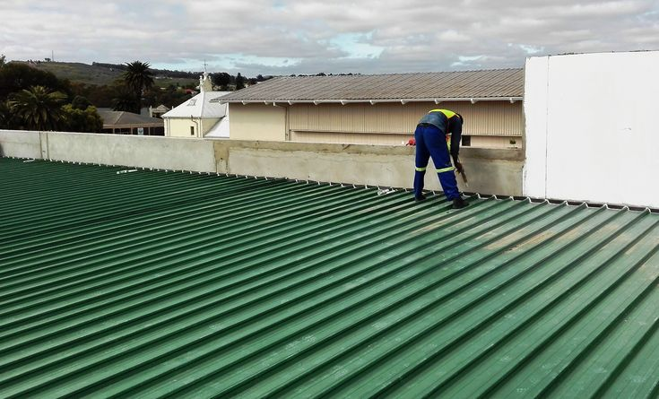 roof sheets secured, special #flashings are being installed #kliplok #heritagegreen #colorbond #paramountroofing