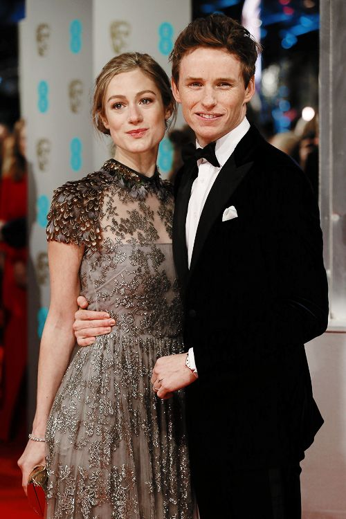 Eddie Redmayne and wife Hannah Bagshawe pose on the red carpet for the BAFTA British Academy Film Awards at the Royal Opera House in London on February 8, 2015