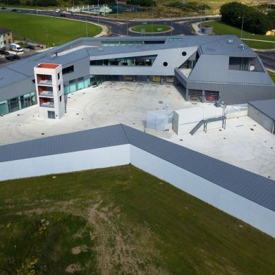 Waterford Fire Station: Location: Waterford, Ireland Year of Construction: 2015 Architects: Mccullough Mulvin Architects  The building serves as a fire house and training center for crisis response services and the design is based around the ability to carry out those life safety services. A enclosed plan allows for the interior space to be used to achieve the programmatic goals of the fires station.