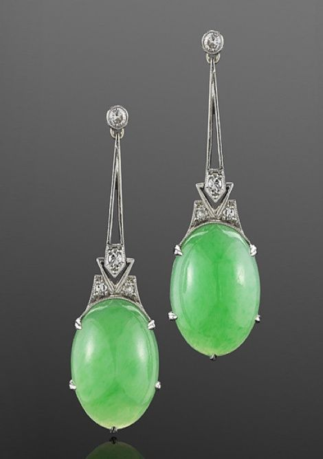 Art DECO__Jade and Diamond Earrings, circa 1920 Bright oval jade cabochons are suspended on diamond and platinum wire work frames.