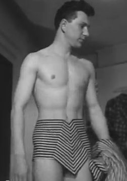 Men's swimwear by British designer,   John Cavanagh, circa 1952.  (Couldn't help but chuckle at the striped, mid-century modernized version of Johnny Weissmuller's loincloth-wearing Tarzan!)