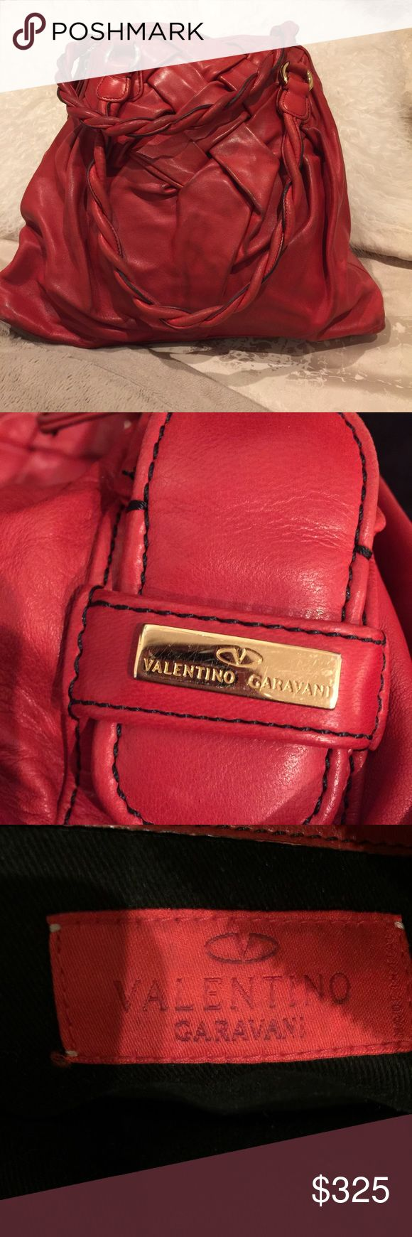 """Authentic Valentino Red Leather Bag Authentic Valentino Garavani Red Leather Bag. Soft Leather, Braided Handles. Roomy! Measures = 13"""" H x 15"""" W x 6"""" D. Handle Drop apx. 9"""" to top of the bag. Purchased at Saks on Fifth Ave. in NYC about 5 years ago. Overall Good Condition. Much Loved. Used A Lot! See Photos for Wear At Corners and Darkening Throughout Bag, Small Water Stain on Bottom. Inside Great Condition. Far From Perfect -- But No Rips, Tears, Etc. Just Regular Wear On Exterior. Ask Qs…"""