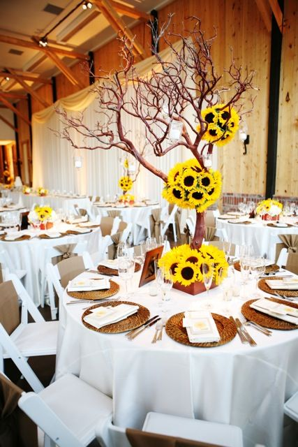 Sunflower ball centerpiece manzanita branches wedding