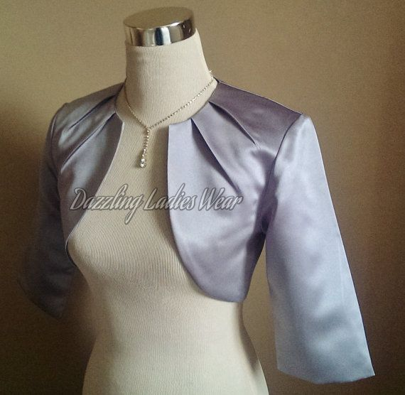 All of our items are handmade and unique to our company. Description-  Beautiful silver/grey soft satin bolero, with a matching satin lining,