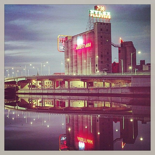 The iconic Melbourne Nylex Clock sign & Ansett-ANA neon sign along the Yarra River, shot in the early 60s by photographer Maggie Diaz @miikey_doom