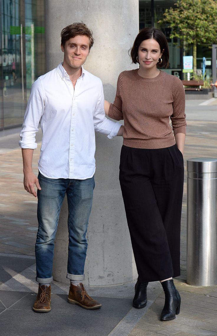 Jack Farthing plays George Warleggan and Heida Reed plays Elizabeth Poldark Warleggan in the BBC/PBS series POLDARK.