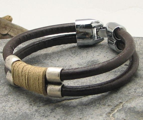 FREE  SHIPPING Men's bracelet leather . Multi strand brown and natural leather with  silver plated spacers and clasp.