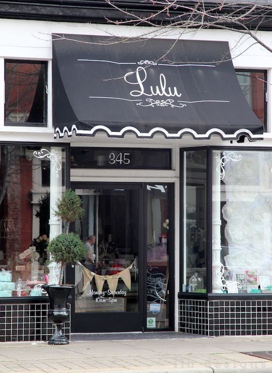 Scalloped awning on this pretty retail store front for Shop front design ideas