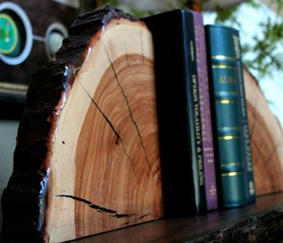 Wildwood Bookends  by Tin Roof Cutting Boards    Coated with a polyurethane finish, these pieces will stand the test of time and adorn your home or office for years to come. Size of bookend is 9x9x2 and sold as a pair. Allow 7-10 days for shipping.