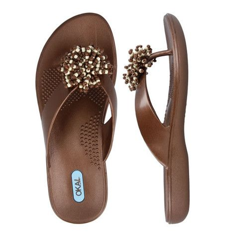 Alicia Copper | Gift from USA - The mini-movement of these beaded pom poms will delight you at every step. Choose from three basic colors to parade about in. With incomparable support, the Alicia is easy to wear from sunrise to sunset. Eco-Friendly, Dishwasher Safe, Made in USA. #sandals #summer #fashion #style #madeinusa #Thongs #flipflops #beach #spa