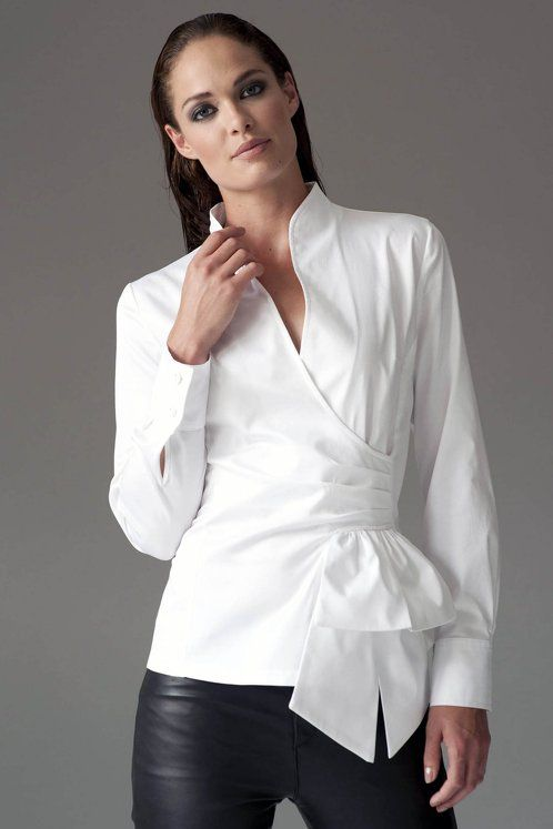 https://www.cityblis.com/item/12537  BARBARA WHITE - $132 by The Shirt Company  Inspired by a 1950's silhouette this modern classic shirt has a nipped-in waist, plunge neckline and peplum. A feminine shirt ideal for work and off-duty.  Also available in Black  White Also available in Black Shirt with diamonte butons on each cuff. Invisible zipper on one side. Body leng...