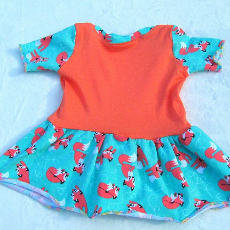 Orange and mint green organic cotton jersey Lillestoff lapneck baby dress with foxes! Super easy to get over baby's head!  SewDomesticated