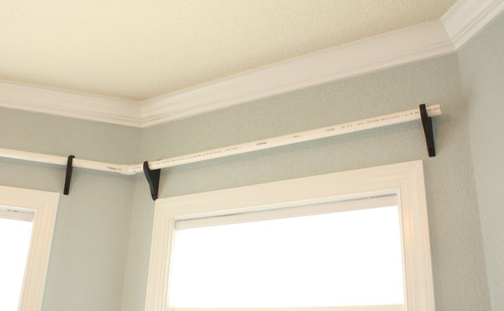 Home Depot brackets and PVC pipe can be spray painted for super cheap curtain rods