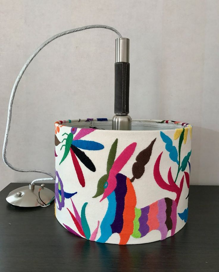Hanging Lamp. Upholstered with multicoloured Otomi fabric.