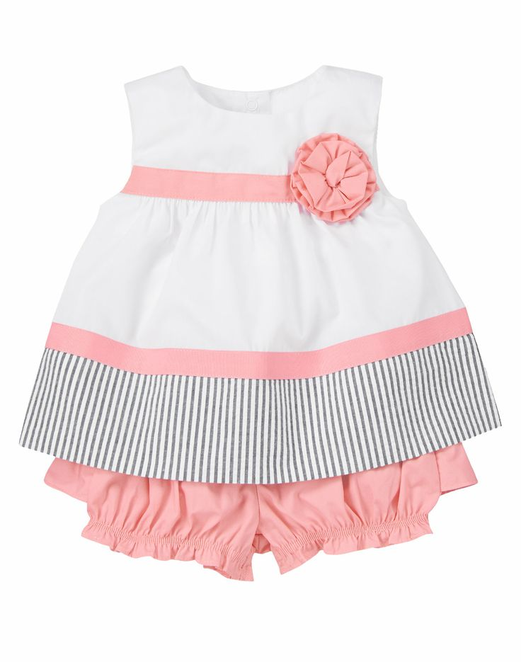 Stylish for spring. Cute two-piece poplin set features a top with a corsage, grosgrain ribbon stripes and a seersucker striped hem. Matching bottom has darling ruffles on the back.