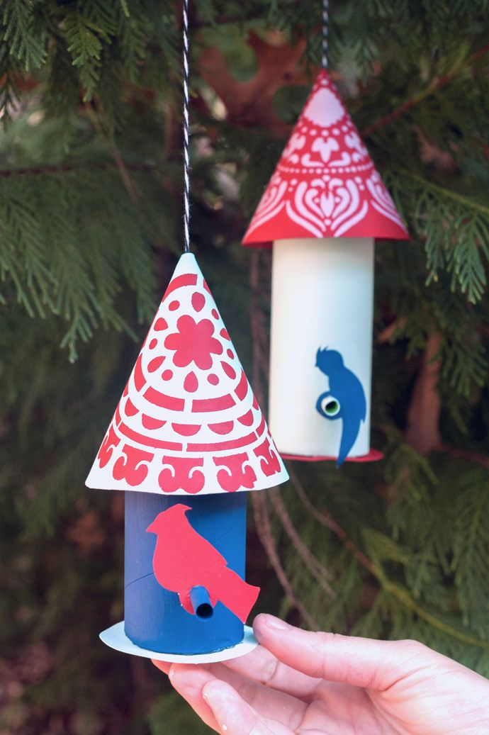 Turn your recycled gift wrap roll into a DIY Bird House Ornament.