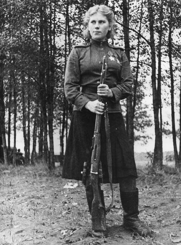 """Sniper Roza Shanina with her rifle (Роза Шанина), 1944.  From her diary:  'The essence of my happiness is fighting for the happiness of others. It's strange, why is it that in grammar, the word 'happiness' can only be singular? That is counter to its meaning, after all. […] If it turns necessary to die for the common happiness, then I'm ready to."""