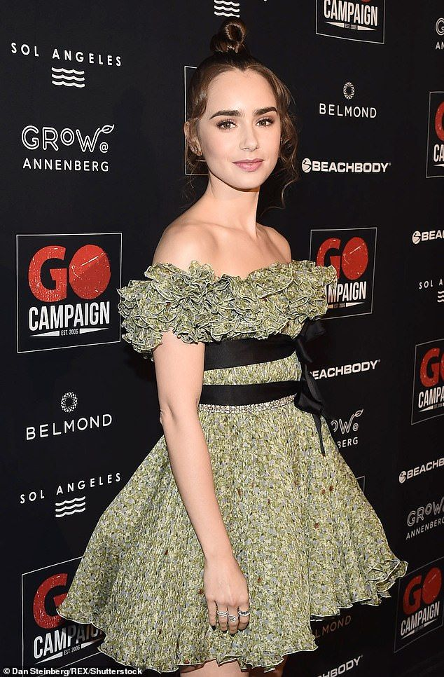 Lily Collins and Robert Pattinson attend the Go Campaign ...