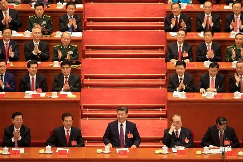 (Front row, L to R) The chairman of the standing committee of the National People's Congress (NPC) Zhang Dejiang, former Chinese president Hu Jintao, Chinese president Xi Jinping, former president Jiang Zemin and Chinese premier Li Keqiang, at the opening ceremony