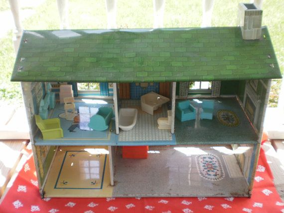 Vintage Toy 1960s Marx Tin Dollhouse. $35.00, via Etsy.  Whoa!!! My old Doll House! It was the Darling family, lol.