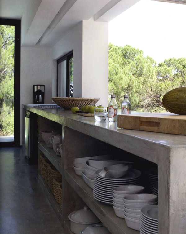 Concrete is an amazing material and I love open cabinets!