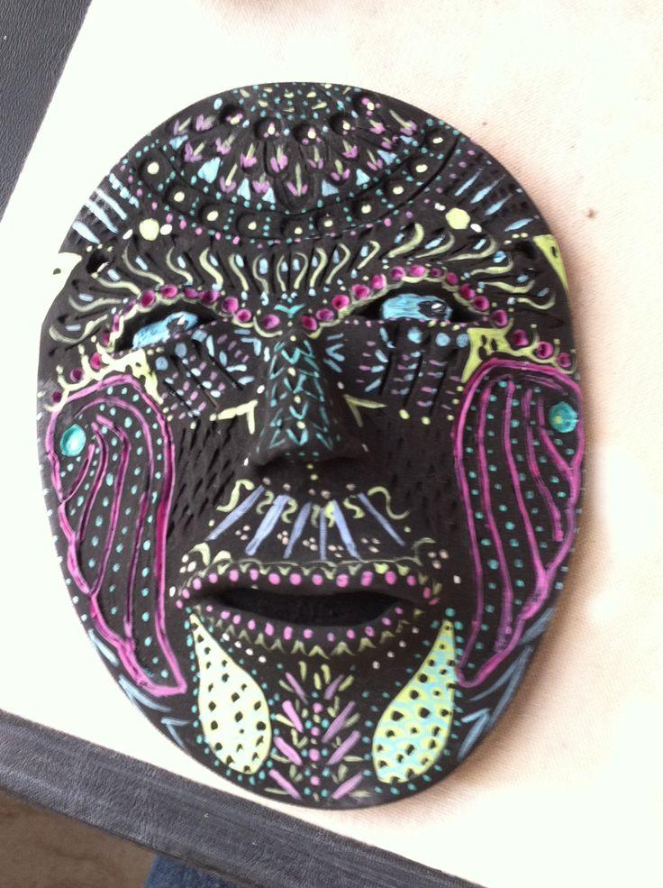 Clay mask, acrylic paint.